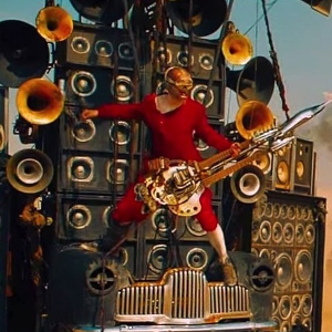 Mad Max Fury Road - The Story of the Blind Guitarist, the Doof Warrior!